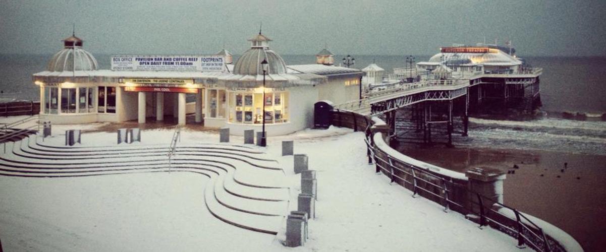 Cromer Pier in snow.
