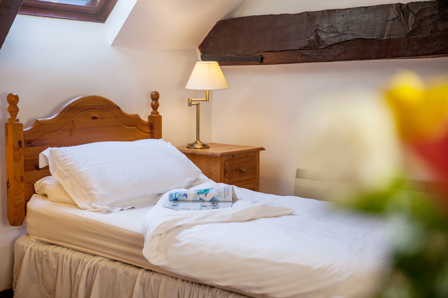 Bedroom inside The Barn holiday cottage at The Grove.