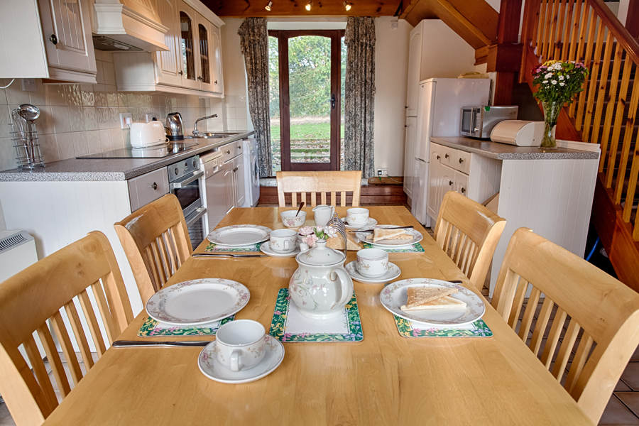 Dining table in The Barn holiday cottage.
