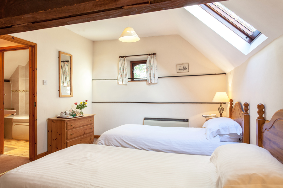 Twin room inside The Barn holiday cottage.